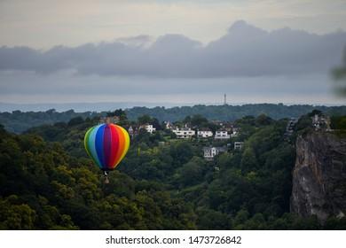 Rainbow balloon flying down the Avon Gorge during 2019 Bristol Balloon Fiesta