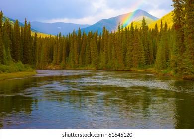 Rainbow in beautiful valley of Big Salmon River, Yukon Territory, Canada