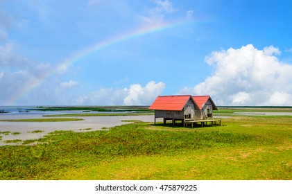 Rainbow behind twin house at seaside of songkhla lake, soft focus.