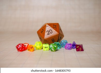 Rainbow and big wooden dice roleplaying (rpg) Dungeons and Dragons DND  set for game night. Natural D20 on a grid mat. Represent LGBT (Lesbian, Gay, Bisexual, Transgender) community in board games.
