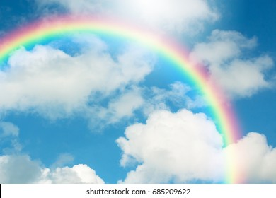 Rainbow in Blue sky with cloud.