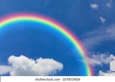 Rainbow and blue sky with clouds