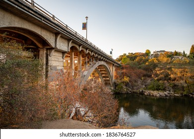 Rainbow Bridge in Folsom, CA with fall colors over water