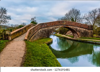 The Rainbow Bridge at Foxton Locks, UK reflected in the Grand Union Canal on a still winter's afternoon