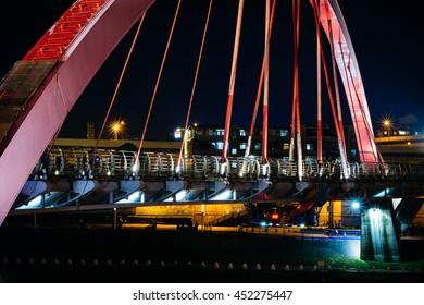 The Rainbow Bridge at night, in Taipei, Taiwan.