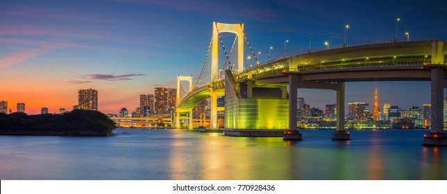 Rainbow Bridge Panorama, Tokyo. Panoramic cityscape image of Tokyo, Japan with Rainbow Bridge during sunset.