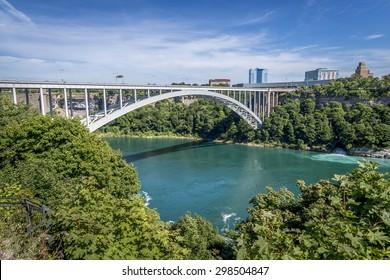 The Rainbow Bridge spans the Niagara River and is a border crossing that joins Niagara Falls Ontario Canada to Niagara Falls New York USA.