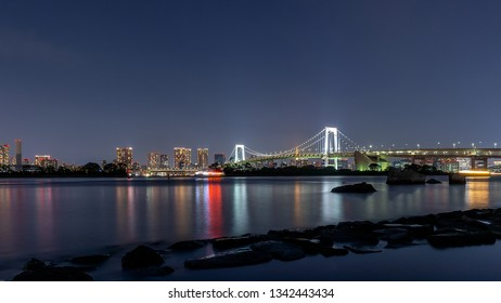 The rainbow bridge in Tokyo as seen from Odaiba beach