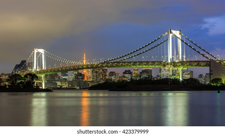 Rainbow Bridge and Tokyo Tower in Tokyo Bay, Tokyo City Skyline background from Odaiba. Japan.