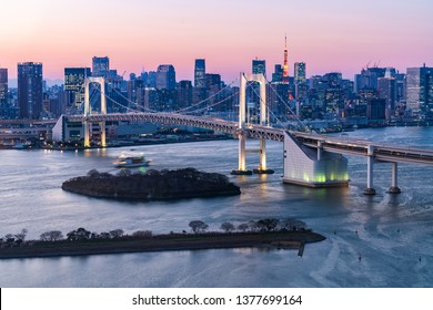 Rainbow bridge and Tokyo Tower during sunset time in Odaiba, Japan, Tokyo