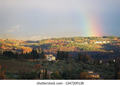 Rainbow in the characteristic landscape of Tuscany: hills, farmhouses, olive trees, cypresses, vineyards. The Chianti hills