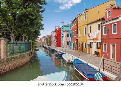 Rainbow city of Burano on a hot summer day.