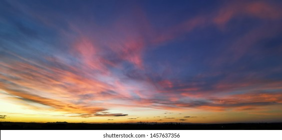 Rainbow clouds form a the sun sets in the Eastern Cape, South Africa. Winter skies produce the best sunsets.