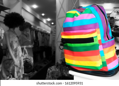 Rainbow color backpack, bag, accessory. LGBT colors. Homosexual multi colored merch, merchandise. One stands out from the gray mass, not like everyone else. Uniqueness, freedom concept
