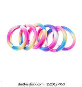 A lot of rainbow color hair ties bands. colorful Scrunchies isolated on white background