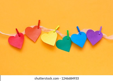 rainbow color hearts on clothespins in row. LGBT symbol. Valentine's Day