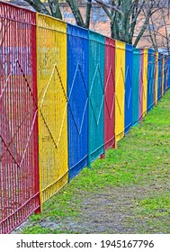 rainbow color metal fence line, restricted zone diversity