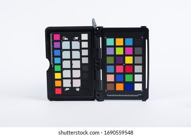 Rainbow color palette or colorchecker calibration passport for post production in photography isolated on white background. Professional photo equipment
