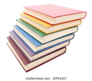 Rainbow colored books isolated on white background