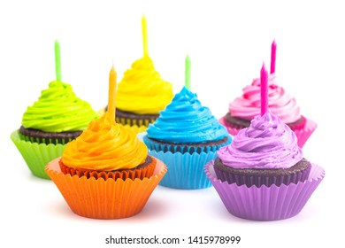 Rainbow Colored Frosted Chocolate Cupcakes Isolated on a White Background