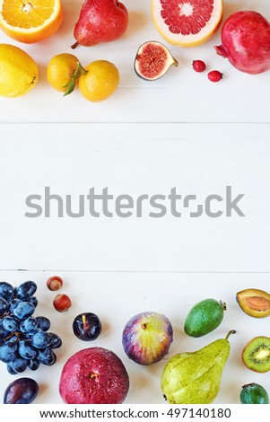Rainbow colored fruits frame over white background. Healthy eating / diet. Juice and smoothie ingredients. Copy space.