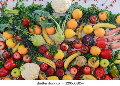 Rainbow colored fruits and vegetables on a white table. Juice and healthy eating thanksgiving day concept.