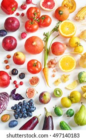 Rainbow colored fruits and vegetables on a white table. Juice and smoothie ingredients. Healthy eating / diet concept.