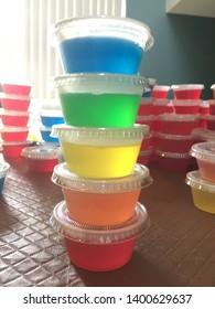 Rainbow colored Jell-O shots. Pride colors.