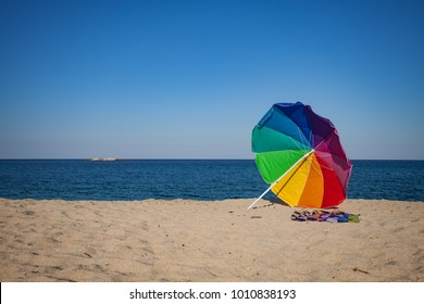 Rainbow Colored Sun Umbrella Beach