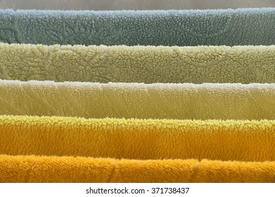Rainbow of colored towels - orange, yellow, cream, green, blue and white
