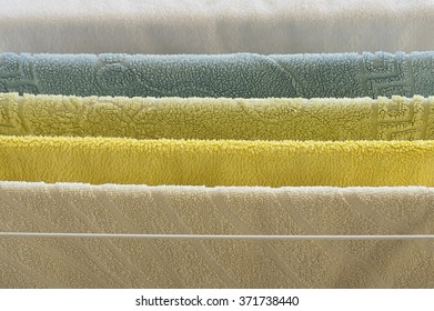 Rainbow of colored towels - yellow, cream, green, blue and white