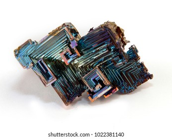 Rainbow colorful mineral bismuth closeup macro on a dark background