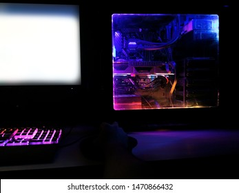rainbow colorful rgb battle station rendering gaming pc led case and mechanical keyboard
