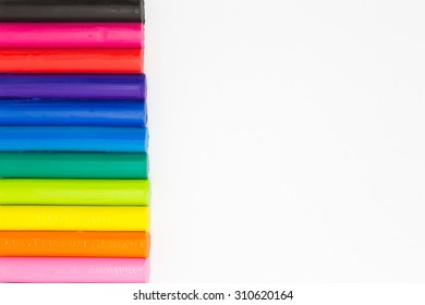 Rainbow colors plasticine for child playing on white background