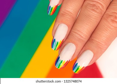 Rainbow design on long oval nails. Nail art. Multicolored French manicure.
