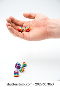 Rainbow dice, representing the wide variety of LGBTQ (Lesbian, Gay, Bisexual, Transgender, and Queer) people who participate in various tabletop games, and the increasing inclusivity of the hobby.