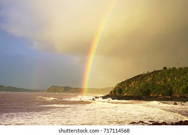 Rainbow ending on the ocean