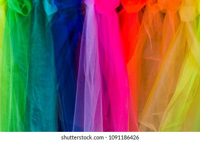 Rainbow fabric background with interesting colors and textures