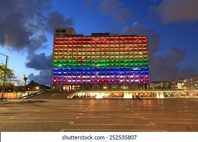 Rainbow flag lighting over Tel Aviv city hall building for pride month