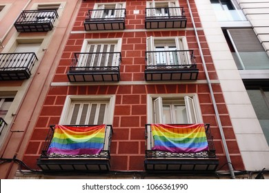 Rainbow flags on the balconies of a house in the Chueca district in Madrid, Spain