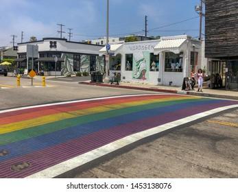 Rainbow gay flag crosswalk in Abbot Kinney Boulevard, Venice, Los Angeles, USA. Colorful pedestrian LGBT crosswalk. 07/13/2019