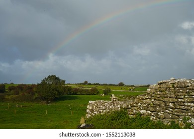 Rainbow in a green field of Ireland's countryside.