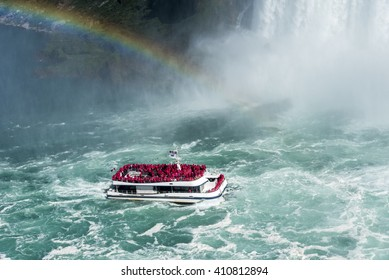 A rainbow guides a tour boat as it plies the turbulent water of the Niagara River on its way to the base of the Horseshoe Falls. Niagara Falls Canada.