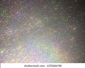 Rainbow and holo silver glitter sparkling texture and bokeh abstract background