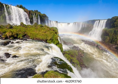 Rainbow and Iguazu Falls. Iguazu Falls are waterfalls of the Iguazu River on the border of the Argentina and the Brazil.