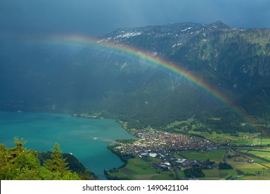 Rainbow at Interlaken town and Aare river, from the point of Harder Kulm, Interlaken, Switzerland.