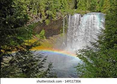 Rainbow at Koosah Falls on the McKenzie river in the central western Oregon Cascade range mountains