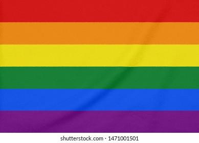 Rainbow LGBT pride flag on a textured fabric. Pride symbol