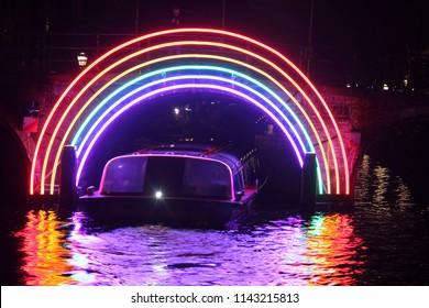 Rainbow light installation on a bridge in Amsterdam, the Netherlands