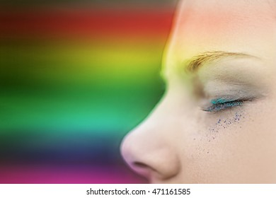 The rainbow light on the girl's face (soft focus and blur background)